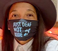 Paramedic wearing 'Just Deaf, Not Rude' mask felt 'very hurt' by ignorant flight attendant