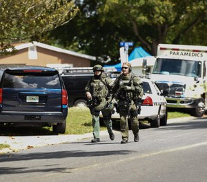 Pinellas Park SWAT officers leave a shooting in 2019. A state law now gives authority to sheriffs and police chief to train SWAT medics to carry firearms in high-risk situations. Police agencies across the Bay Area are training SWAT medics to carry the weapons. The law does not allow them to carry firearms for routine calls. (Photo/Allie Goulding, Tampa Bay Times)
