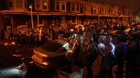 Philadelphia protests continue; father of man shot by police condemns looting