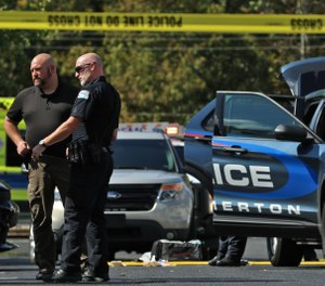 Police, fire and EMS on the scene of a shooting that occurred Tuesday afternoon at the Hampton Meadows Apartments in Cramerton. (Mike Hensdill/The Gaston Gazette)