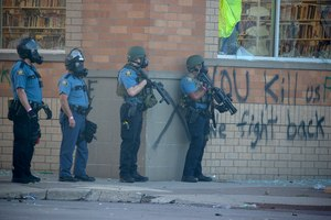 St. Paul police fire tear gas on protestors along University Avenue in Minneapolis during a third day of protests following the death of George Floyd while in Minneapolis police custody, on Thursday, May 28, 2020. Image: Elizabeth Flores/Minneapolis Star Tribune via TNS