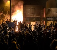 Video: Minneapolis protesters set fire to police precinct