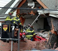 2 killed after car crashes through 2nd floor of N.J. building