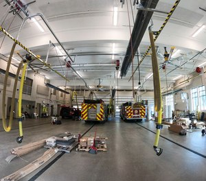The four-door apparatus bay inside the new Portage Fire Station No. 2 at 6101 Oakland Dr. In Portage, Michigan. The new fire station is adjacent to the old station that was built in 1974. The new station is 18,364 square feet compared to the 8,000 Sq. Ft. of the old station.