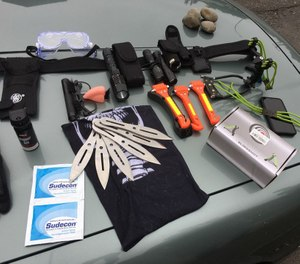 These weapons and tools pictured were among items taken as evidence after a man broke a police patrol vehicle window and pepper-sprayed the officer who sat inside. (Photo/Portland Police Bureau)