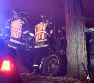 Woodstock Fire and Rescue District firefighter Ryan Mains at a triple fatal accident on Lily Pond Road on Dec. 16, 2018, in Woodstock.