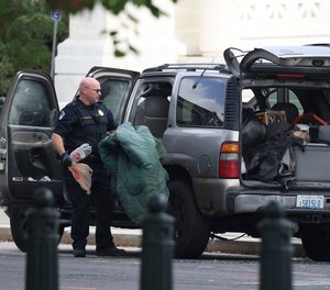 Members of U.S. Capitol Police investigate a suspicious vehicle outside the U.S. Supreme Court on Tuesday, Oct. 5, 2021, on Capitol Hill in Washington, D.C.