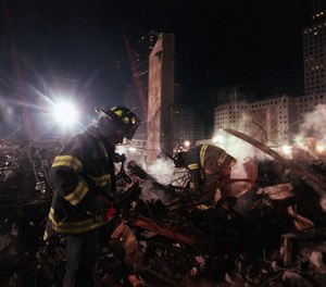 Firefighters from Staten Island's Rescue 5 company search for victims in the pile at Ground Zero in December 2001. Eleven members of the company were killed in the World Trade Center attacks.