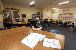 Natalie Burge, teacher at Giano Intermediate School in West Covina, CA on Tuesday, June 2, 2020. As schools finalize plans for reopening in the fall, many parents worry how they'll be able to manage continued distance learning. Image: Myung J. Chun/Los Angeles Times