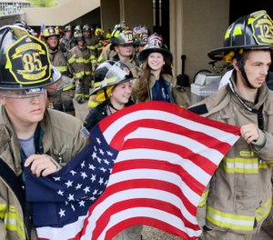 Firefighters and other first responders walk together as a group after climbing 110 flights of stairs during the fifth annual CNY Memorial Stair Climb.(Photo/Tribune News Service by Alex Cooper, Observer-Dispatch)