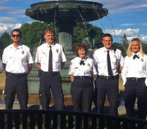Dan McCall, fourth from right in a group photo with other West Brookfield Rescue Squad members from a few years ago. (Photo/Tribune News Service)