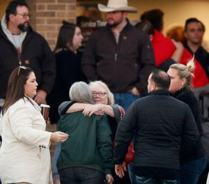 Church and community members gathered outside the West Freeway Church of Christ inFort Worthbefore candlelight vigil, Monday evening,Dec. 30, 2019. A gunman shot and killed two parishioners before an armed security officer returned fire, killing him yesterday during their service. (Tom Fox/The Dallas Morning News/TNS)