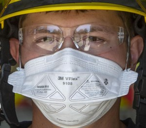 Eugene Springfield Firefighter-Paramedic Joey Parsons wears a mask in this April 2020 photo. (Photo/Chris Pietsch)