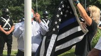 Thin blue line flag removed from Mass. firetruck gets permanent home at county jail