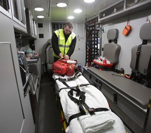 Massillon Firefighter-Paramedic Zach Runion goes over a supply check in a squad. The Massillon Fire Department began providing medical transports 10 years ago as a way to both save money in EMS fees and generate revenue. (Photo/Kevin Whitlock, IndeOnline.com)