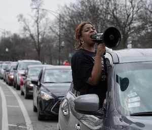 Ana McCullom and a coalition of activists from across the Chicago area protest in a caravan of vehicles to slow traffic on S. California outside the Cook County Jail calling for the mass release of incarcerated people in the state of Illinois to prevent the further spread of COVID-19. (Photo/ E. Jason Wambsgans of Chicago Tribune via TNS)