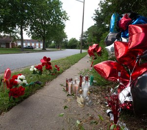 A makeshift memorial on Atlantis Drive in Virginia Beach for a victim of a motorcycle accident is seen on Wednesday, July 1, 2020. Virginia Beach Fire Chief David Hutcheson says reports about first responders being attacked at the scene of the June 29 crash were