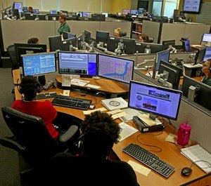 Operators answer emergency calls at a Broward County 911 dispatch center in July 2015. Many patients with nonemergency concerns call 911 because they don't see an obvious alternatives, said Dr. Peter Tanghe.