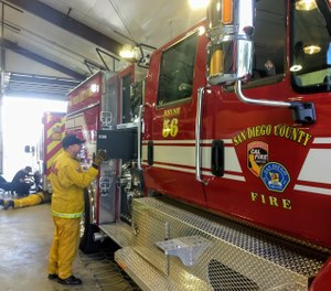A new San Diego County Fire Authority brush engine is one of several vehicles now assigned to the former Julian volunteer station. County firefighters took up 24/7 residence at Station 56 on Wednesday. (Photo/J. Harry Jones, San Diego Union-Tribune)