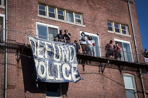 Protesters gather outside the Northampton Police Station to make their voices heard. Image: Douglas Hook/masslive.com via TNS