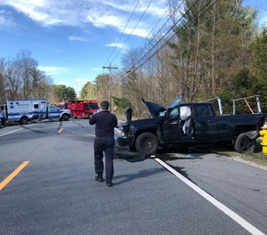 Investigators were at the scene of a crash involving an ambulance and pickup truck on Tuesday afternoon. (Photo/Charlton Police Department Facebook)