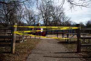 A Michigan playground is marked with caution tape after being closed on Friday, March 27, 2020. Image: mlive.com/Jenna Kieser