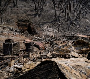 This photo shows burnt out wreckage at a property along CA-128 where the LNU Lightning complex fire tore through last week, photographed on Tuesday, Aug. 25, 2020 in Napa, CA. Newly-implemented technology may help firefighters battling devastated wildfires in California this year better predict their spread.