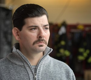 Worcester Firefighter Jerry Lucey talks about his father, Jeremiah Lucey, who died in the Worcester Cold Storage and Warehouse Co. fire 20 years ago. (Photo/Rick Cinclair, Telegram & Gazette)