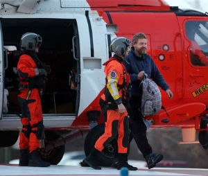 Louis Jordan, right, walks from the Coast Guard helicopter to the Sentara Norfolk General Hospital in Norfolk, Va., after being found off the North Carolina coast, Thursday, April 2, 2015. His family says he sailed out of a marina in Conway, South Carolina, on Jan. 23, and hadn't been heard from since. (AP Photo/The Virginian-Pilot, Steve Earley)