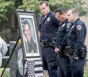 Downey police officers pay their respects at a makeshift memorial for slain Whittier police officer Keith Boyer on Feb. 21, 2017 in Whittier, Calif. (Irfan Khan/Los Angeles Times/TNS)