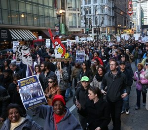 Sub.  Activist groups take over RandolphStreet as a protest, Justice for Laquan, marches as the city council meets, Wednesday, Dec. 9, 2015 in Chicago.