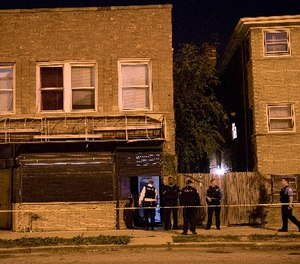 Members of the Chicago Police Department work at the scene of a fatal shooting in the 400 block of East 107th Street Thursday, Nov. 17, 2016, in the Rosemoor neighborhood of Chicago. (Erin Hooley/Chicago Tribune/TNS)