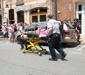 Multiple people were injured when a vehicle plowed into pedestrians in downtown Charlottesville, Va., following confrontations between alt-right followers and liberal activists on Saturday, Aug. 12, 2017. (Albin Lohr-Jones/Sipa USA/TNS)