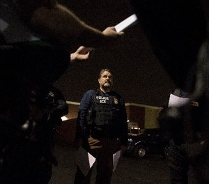 Immigration and Customs Enforcement fugitive operations team assistant director Jorge Field confers with team members in Downey, Calif., on April 18, 2017. (Brian van der Brug/Los Angeles Times/TNS)