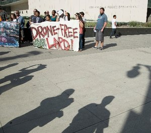 Protestors show their opposition to the LAPD getting drones on Aug. 8, 2017 in Los Angeles.