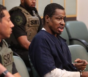 Markeith Loyd, right, accused of killing Orlando Police Lt. Debra Clayton as well as his pregnant ex-girfriend, converses with Orange-Osceola Chief Judge Frederick Lauten Wednesday, March 1, 2017 in Orlando, Fla. (Red Huber/Orlando Sentinel/TNS)