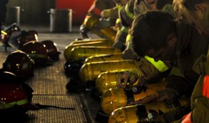 Firefighters tending to SCBA.