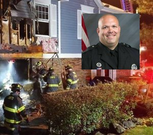 Officer Bill Wise helped rescue a 14-year-old boy who was trapped in the basement during a house fire.