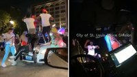 Video: Mob jumps on cruiser with St. Louis officer inside