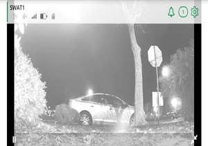 """Decoy car and the utilization of a hidden camera, containing both a commonly stolen item employing a GPS device, coupled with a WiFi hotspot labeled """"Jason's MacBook"""" used to attract criminals targeting Apple computer devices."""