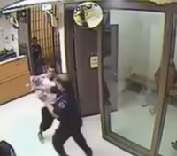 Video review: Inmate punches officer during jail booking