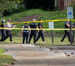 Police work the scene where eleven people were killed during a mass shooting at the Virginia Beach city public works building, Friday, May 31, 2019 in Virginia Beach, Va.