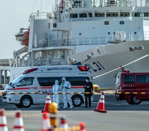 An ambulance carries a coronavirus victim from the Diamond Princess cruise ship while it is docked at Daikoku Pier where it will be resupplied and newly diagnosed coronavirus cases taken to hospital. It remains in quarantine off the port of Yokohama after a number of the 3,700 people on board were confirmed to have coronavirus, on February 6, 2020 in Yokohama, Japan.