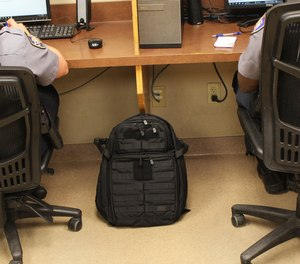 Cops don't carry briefcases. We carry backpacks.