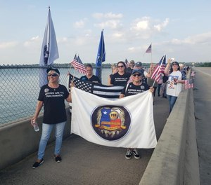 The #Walkthebridge movement provides officers the opportunity to discuss with peers, friends and others some of the issues they have battled. (Photo/John Salerno)