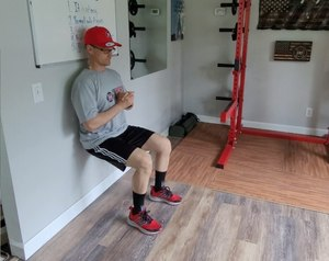 The wall sit is an isometric, quad- and glute-strengthening exercise.