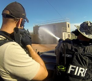 Personnel providing fire protection with SWAT. (Photos/LFRA)