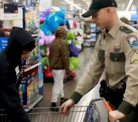 Wash. 'Shop with a Cop' Walmart program provides kids with gifts, clothing