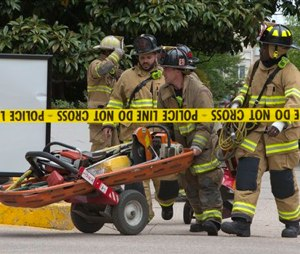 DC Fire Department move equipment into the garage at the Watergate complex after a structural collapse incident. (AP Photo/Jacquelyn Martin)