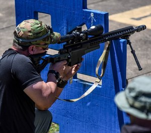 "A police sniper from the DeKalb County (Georgia) Police Department fires his Accuracy International AXMC rifle with 18"" barrel in .338 Lapua Magnum during training. Modular, multi-caliber rifles like this allow police snipers to be ready for any mission."